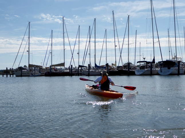 Paddling past sailboats in the Oxford Harbor