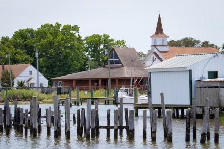 The Smith Island Cultural Center (brown building in front of Church)